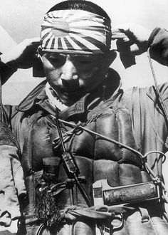 A Kamikaze pilot, armed with an uncommon M. Zulaica y Cia Royal 7.65mm caliber pistol. Produced in Spain during the 1920s, it has a long grip frame holding a 12-round higher-capacity magazine. Japanese officers could buy a foreign weapons as their personal sidearm.