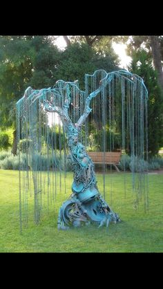 Steampunk, weeping, metal tree.  Beautiful design!