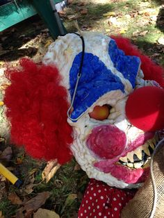 Use spray insulation to make this scary clown face. The clown head was bigger than life-size. Great effect!