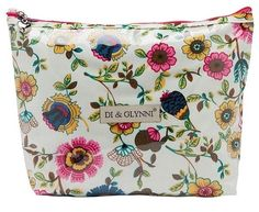 Put your cosmetics in something pretty and colorful like this gorgeous floral cosmetic bag. Shop now!