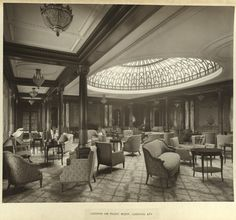 Title: Lounge or music room, looking aft      Creator: Bedford Lemere & Co. [attrib.]   Date: ca. 1906-1907  Part Of: R.M.S. Mauretania  Description: This is the 12th photograph in an album containing 30 prints of the Cunard line's Royal Mail Steamship, Mauretania.   Physical Description: 1 photographic print: gelatin silver; 25 x 29 cm. on 31 x 42 cm. mount  File: ag1982_0116_album_22_sm_opt.jpg     Rights: Please cite DeGolyer Library, Southern Methodist University when using this f...