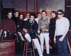 In this Jan. 22, 1969 photo provided by Elvis Presley Enterprises, Inc., Elvis Presley, center, poses for a photo at American Sound Studio with The Memphis Boys, an acclaimed studio band that worked w