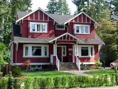 I've always loved red siding, white trim and dark roof's