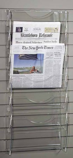 ClearDisplays.com offers this newspaper ladder, just the right size for a small selection and a small space on a wall.