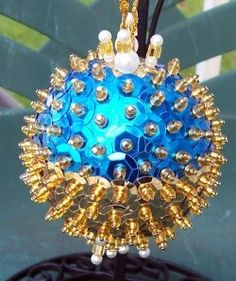 Making sequin and beaded Christmas ornaments created on a styrofoam ball.