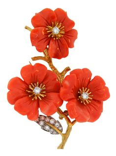 "1960's BOUCHERON Paris Carved Coral Diamond Gold Flower Pin, Sweet and feminine brooch created by Boucheron, Paris in the 1960's. Inspired by nature, and flower motifs, the pin features a stem with three beautiful flowers made of carved coral and accented with round diamonds. The flowers are 1"" in diameter. The pin is 2-1/2"" high and 1-3/4"" wide. It has a French hallmark for 18k gold and Boucheron maker's mark. 1stdibs.com"
