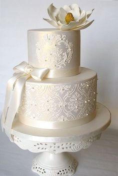 Tartas de boda - Wedding Cake - Ivory lustered wedding cake with stencilling, ribbon and flower
