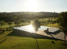 simple elegance in a square infinity edge reflection pool protruding out from a sloping landscape makes a statement.