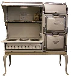 """I want to own a 1950s version of an electric stove. I like this model, but in the vintage minty blue Hotpoint Automatic electric 6-burner, by GE, features a double oven. Circa 1925-1934. 5' wide, 28"""" deep, 71"""" tall."""