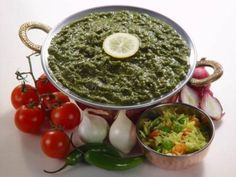 Saag. Saag is the name given to a dish of green leaves of certain edible vegetables which is cooked on its own with butter, garlic, turmeric, cumin, coriander and other spices.