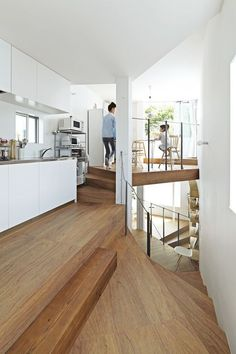 The top of the house is dedicated to a dining area and a kitchen outfitted with steel-topped cabinets from Sanwa Company. Read more about this  dimensional three-storied Japanese home here.