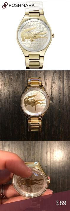 Gold Valencia Lacoste Watch Good condition gold Lacoste watch. Wore once or twice and I forgot to take the plastic covering the face off so that's still on. A couple of Very light scratches on gold from normal wear of a watch. Hardly noticeable unless looking for it. I got the watch sizes but I have the extra links for it so it can be resized to be made bigger if you have to.  Lacoste watches are made by Movado :) Lacoste Accessories Watches