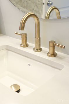 american standard sink and brass faucet. come see this bathroom refresh with inexpensive fixtures and faucets from Lowe's bathroomdesign brassfaucet bathroom 428053139584340262 Brass Bathroom Fixtures, Bronze Bathroom, Brass Faucet, Bathroom Sink Faucets, Shower Faucet, Modern Bathroom, Small Bathroom, Bathroom Ideas, Bathroom Organization