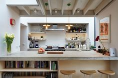 Fraher Architects expanded a flat in northwest London to include a kitchen.  If you've ever wondered what chefs want out of their own kitchens, Fraher Architects' latest project offers one answer: simplicity. Through an extension to an existing flat, they gave their client, who runs several fast-paced restaurants, a no-fuss cooking space where she could relax and socialize in the off hours with friends.