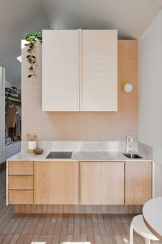 blush pink kitchen with wood cabinets