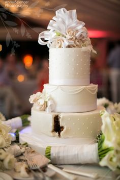 """Anna and Spencer Photography , Atlanta Wedding Photographers . Wedding cake after """" cutting of the cake """" at a wedding reception on Grand Cayman Island ."""