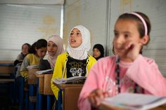 PHOTO OF THE WEEK - 27 September 2013  ---  Since the last school year, almost 2 million Syrian children have dropped out of school. As Syria and neighbouring countries prepare for a new academic year, UNICEF is boosting efforts to ensure that children safely return to learning. In Jordan, these efforts include a Back to School campaign to promote enrolment. Children attend class in Za'atari, now the world's second-largest refugee camp. ©UNICEF/Shehzad Noorani   http://www.unicef.org