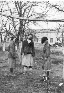 Schtygry, USSR, early 1942. Three women hanged for spying.