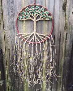 Another tree-inspired dream catcher with more beads and complicated (but you can still learn) knots.
