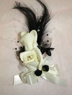 Black and ivory feather corsage