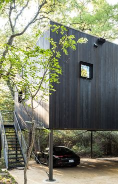 The PH2 Treebox was built on a wooded property in Dallas with an existing split-level home.