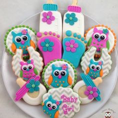 Bright and colorful owl cookies for a baby shower today #babyshower #babyshowercookies #owlcookies #babybottlecookies #bibcookies #pacifiercookies #babyfootcookies #babyowlcookies