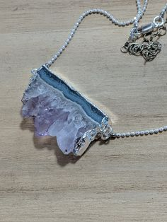 This stunning raw amethyst is silver plated and hangs from a silver plated chain. Choose from two styles...one short with a single strand of chain. The other long with a three varying styles of cha... Sea Jewelry, Handmade Jewelry, Jewellery, Faceted Crystal, Crystal Pendant, Amethyst Crystal, Ball Chain, Silver Plate, Arrow Necklace