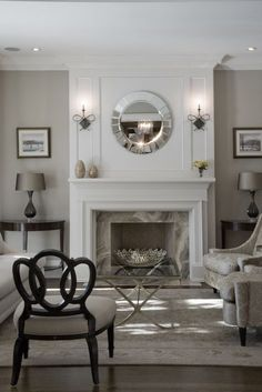 Glamorous living room via www.cmidesign.ca #CMID featuring the Barbara Barry Bracelet Chair & two Joan Chairs from her collection with Henredon