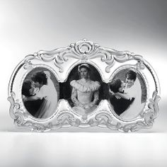 This lovely crystal frame features dramatic swirls and elaborate cuts for an exceptional presentation.