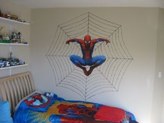 I drew the spiderweb and painted the lines with a thin black brush, then I added the spiderman sticker, and voila!  Spiderman room complete!