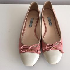"PRADA PATENT CAP-TOE BALLERINA FLAT LIGHT PINK PRADA PATENT CAP-TOE BALLERINA FLAT LIGHT PINK, VERNICE SAFFIANO, SIZE 37, CONTRAST CAP-TOE. DELICATE BOW AND LOGO ORNAMENT ATOP VAMP. 1/2"" COVERED FLAT HEEL, LEATHER IN SOLES, MADE IN ITALY, NO SIGNS OF WEAR ABOVE SOLE, GENTLY USED IN EXCELLENT CONDITION, COMES WITH DUST BAG Prada Shoes Flats & Loafers"