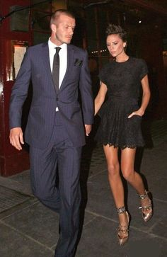 Who made Victoria Beckham's black lace dress and gold spike shoes? Shoes – Christian Louboutin For Rodarte Spiked Mary Janes  Dress – Balenciaga Lace Mini Dress