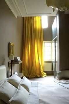 love the yellow drapes against a grey wall