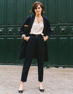 navy coat + nude silk button-up + high-waisted black trousers + black ballet flats + black tote