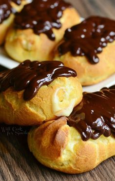 Homemade Boston Cream Eclair - Made with simple pate au choux, filled with homemade vanilla bean custard and topped with rich chocolate ganache.