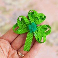 The Luck o' the Irish will be with you with this beautiful woven ribbon shamrock. Add to a barrette/pinback to wear on St. Patrick's Day!