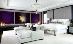 Twin chaise lounge chairs in white fill up this contemporary bedroom beautifully