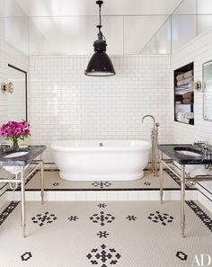 A tub by the Water Monopoly anchors the master bath   archdigest.com