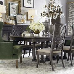 like using different chairs at the ends, the table with grey hues, chandelier, etc.  Emporium Dining Room by Bassett Home Furnishings.