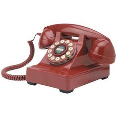 """Vintage-inspired corded desk phone with a rotary button dial.      Product: Desk phone    Construction Material: Metal  Color: Red      Features:   Rotary dial with push button technology    Flash/redial   Ringer volume on/off switch   Earpiece volume control          Dimensions: 5.5"""" H x 8.75"""" W x 7.5"""" D"""