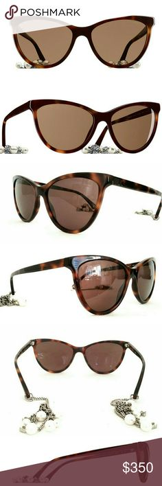 """CHANEL LOVELY PEARL SUNGLASSES """"LOVELY PEARL"""" LATEST COLLECTION ~ BRAND NEW  CHANEL CAT EYE POLORIZED SUNGLASSES WITH BROWN GRADIENT LENS   There is a very small scratch on the outside right lense that I can't pick up with the camera. Very minor otherwise in excellent condition. I only wore them a couple of times    CAT EYE-ACETATE SUNGLASSES, TEMPLE TIPS EMBELLISHED WITH SILVER CC PENDANT CHAINS AND FANTASY PEARLS. Current in the Chanel Boutique retailing for 1000.00 plus tax.   Comes with…"""