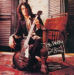 Joe Perry Signature Les Paul Guitar- had this poster on my wall until i moved out of my parents house, wish i still had it!