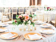Small lush centerpieces by Kate Foley Designs with gold table numbers and gold chargers with menu folded in napkin and gold chiavari chairs for summer wedding at Hickory Street Annex in Dallas, TX - Photos by Elisabeth Carol Photography