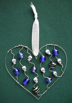 Blue Skully Heart - a suncatcher in glass beads and steel wire
