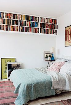 love the books up at the ceiling. those shelves are perfect.