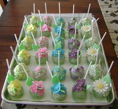 moms-day-pops - an assortment of floral cake pops with sprinkles or scrolls, candy clay adornments