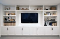 A wall of built-ins for a family room media center. – Addition on Three Floors – Board & Vellum