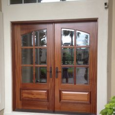 Sapelle Mahogany with custom beveled glass with multi point locking system with Emtek hardware  installed by Heckard's Door in Deercreek in Jax, Fl
