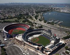 New York Mets Shea Stadium and Citi Field right next to each other in Flushing, New York. New York Mets Baseball, Baseball Park, Baseball Pitching, Ny Mets, Baseball Scoreboard, Shea Stadium, Yankee Stadium, New York Stadium, Lets Go Mets