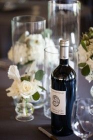 Sweetgrass Social wedding at Alhambra Hall. Erika & Sergio. Wine bottle used as table number.